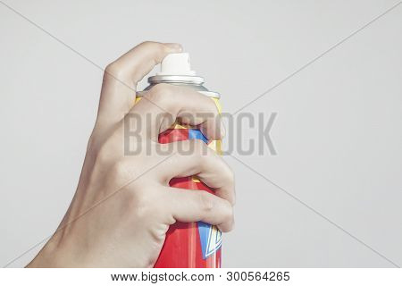 Person Using A Spray For Killing Mosquitoes, Aerosol Against Mosquitoes And Flies. Mosquito Control