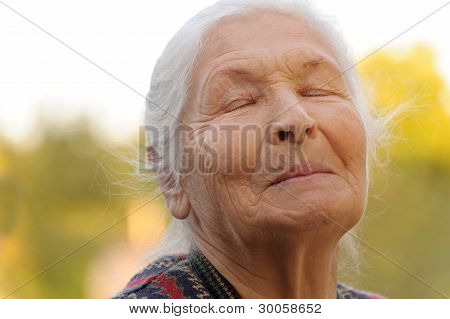 The Elderly Woman With Closed Eyes