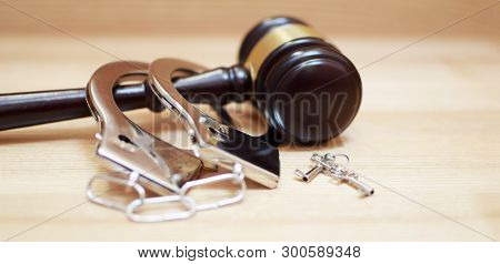 Judges Gavel Or Law Mallet, Handcuffs And Key On Light Wooden Background With Copy Space. Judgement,