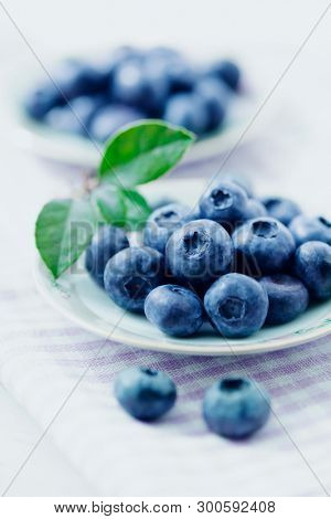 Fresh blueberries on two plates