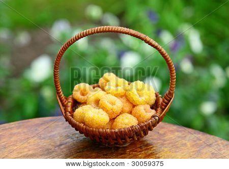 Basket Of Yellow Raspberries In The Garden
