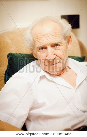 Senior Man In An Armchair