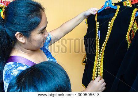 Labuan,malaysia-may 12,2019:kadazandusun Woman In Shop Looking & Choosing The Traditional Costume  F
