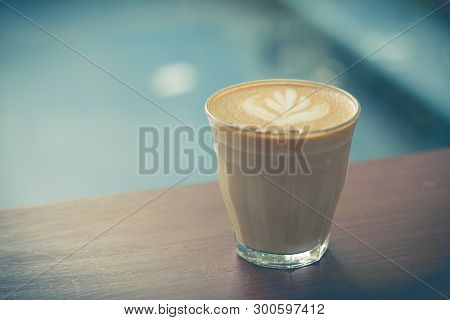 Picture Of  Latte Or Cappuccino Coffee With Latte Art On A Wooden Table