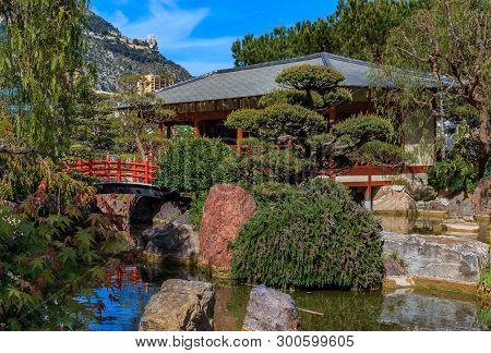 Red Pagoda And A Koi Pond In The Tranquil Japanese Garden Or Jardin Japonais In Monaco, Monte Carlo