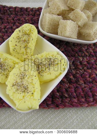 Homemade Butter Pieces With Seasoned Salt And Bread Cubes