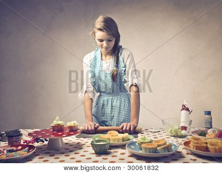 Teenage girl baking sweets