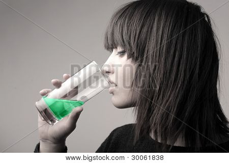 Young woman drinking a medicine