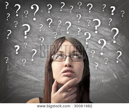 Woman with doubtful expression and question marks all over her head