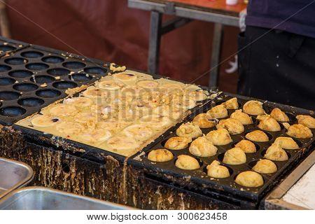 Cooking Takoyaki (octopus Ball), Famous Osaka Snack, On Hot Pan
