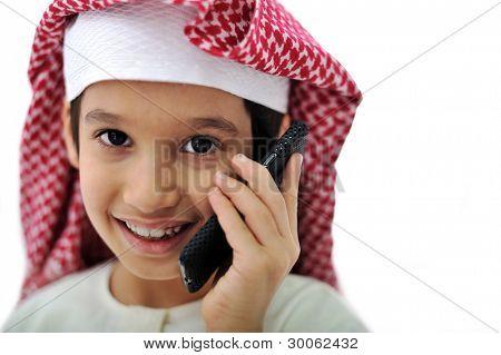 Portrait of arabian kid speaking on phone