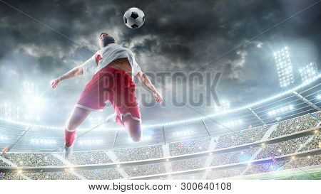 Taking The Ball On The Chest In Football. Jumping A Man In Action, Movement At Game. The Soccer Play