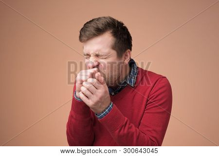 Handsome Mature Manin Red Sweater Coughing A Lot.