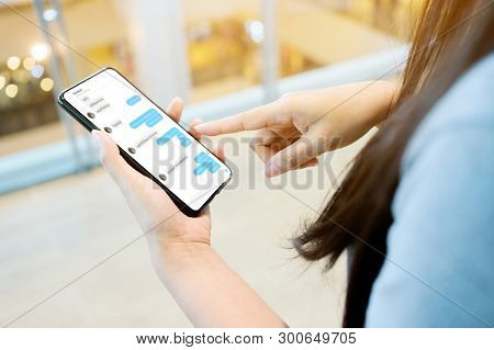 Woman Using Her Mobile Smartphone. She Chatting With Friend On Mobile Phone