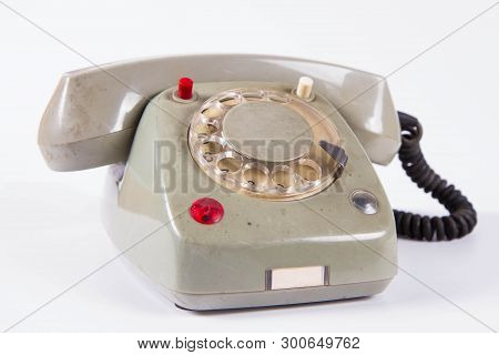 An Old Vintage Phone With Rotary Dial