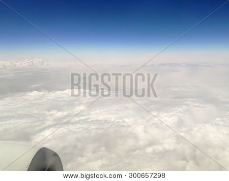Clouds As They Are Seen From Airplane, Sky With Clouds Background, Amazing Flight Over Fluffy Clouds