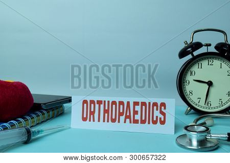 Orthopaedics Planning On Background Of Working Table With Office Supplies. Medical And Healthcare Co