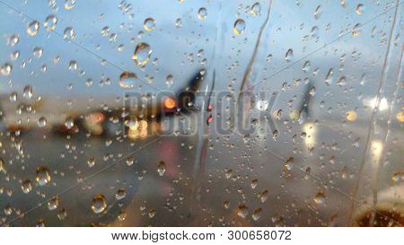 Rainy Airplane Field Through The Airplane Window, Abstract Travel Background, Good-bye Conceptual Ph