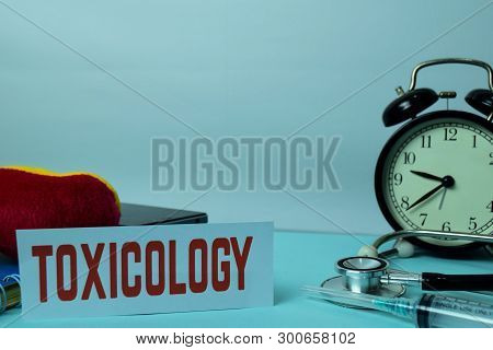 Toxicology Planning On Background Of Working Table With Office Supplies. Medical And Healthcare Conc