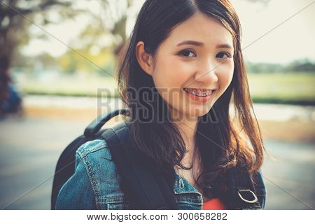 Close Up Traveler Backpacker Young Asian Woman Happy Smiling Face Smile With Gum In Nature. Gums Rec