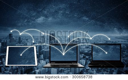 Laptop Computers With Network Connection And Sharing Data To Other Devices. Internet Networking And