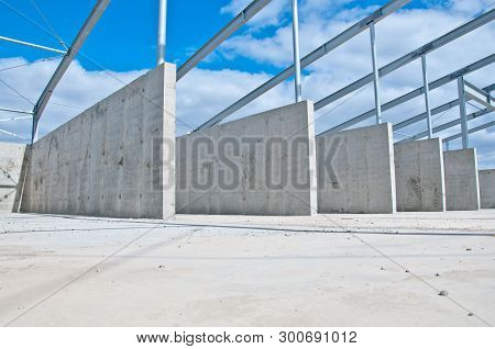 Reinforced Concrete Construction At The Construction Site. The Use Of Concrete And Metal Frame For T