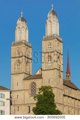 Towers Of The Grossmunster Cathedral In The City Of Zurich, Switzerland. The Twin Towers Of The Gros
