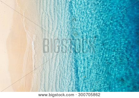 Beach And Ocean As A Background From Top View. Azure Water Background From Top View. Summer Seascape