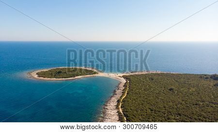 Spectacular Aerial Sea Landscape Of Rocky Coast And Crystal Clear Water.