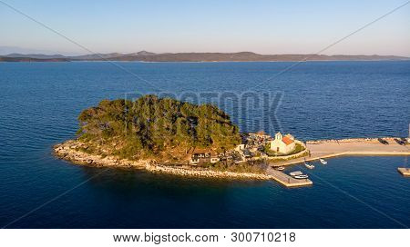 Spectacular Aerial Landscape With Fishing Village Near Peninsula Stretching Into The Sea.