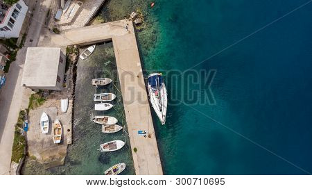 Drop Down View Of Fishing Port With Boats Tied In.