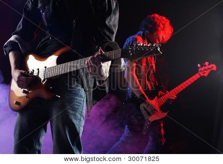 Rock Musicians Playing At A Live Concert