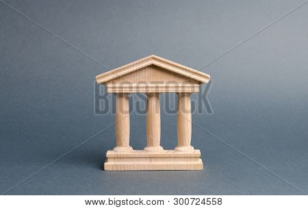 Wooden Government Building On A Gray Background. The Authorities, The Sovereignty Of The Country And