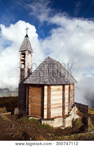 Small Wooden Church Or Chapel On The Mountain Top Col Di Lana And Cloudy Sky, Alps Dolomites Mountai