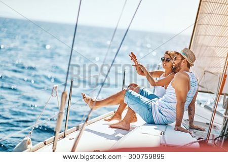 Happy lovers relaxing on a luxury yacht. Happy couple on cruise.
