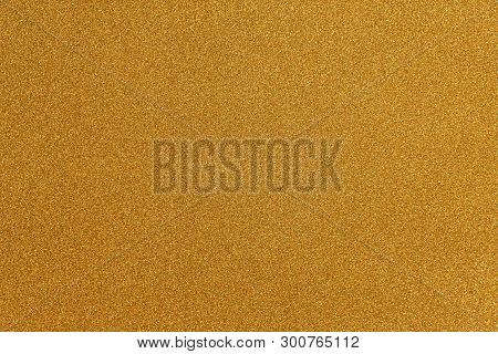 Abstract Gold Glitter Paper Texture Background Or Backdrop. Empty Shimmer Paper Or Yellow Shiny Pape