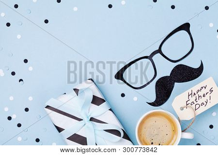 Holiday Breakfast On Happy Fathers Day With Coffee, Gift Box And Funny Glasses And Moustache On Tabl