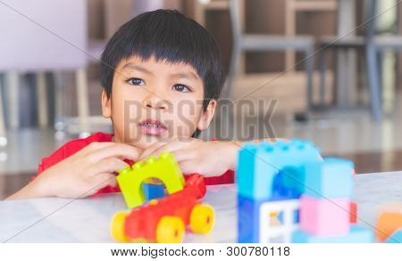 Happy Boy Stacking Toy Blocks On A Living Room For Educational Toy