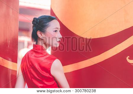 Portrait Of A Chinese Woman Infront Of Temple Gate