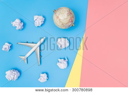 White Plastic Toy Plane On Blue Yellow Pink Flat Lay Top View