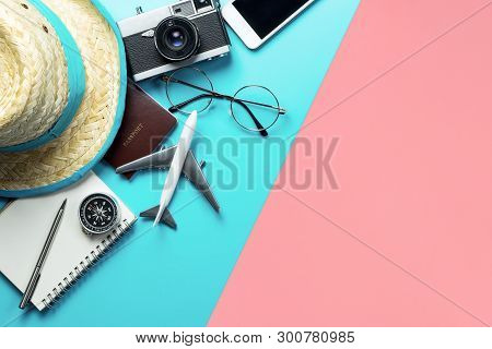 Travel Accessories Objects And Gadgets Top View Flatlay On Blue Yellow Pink