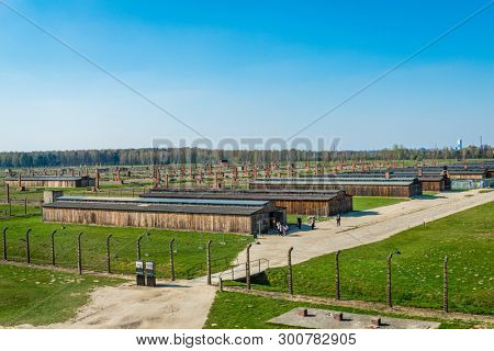 AUSCHWITZ (OSWIECIM), POLAND - APRIL 18, 2019: Aerial view over the concentration camp with some remaining barracks in Auschwitz Birkenau extermination death camp, Poland.