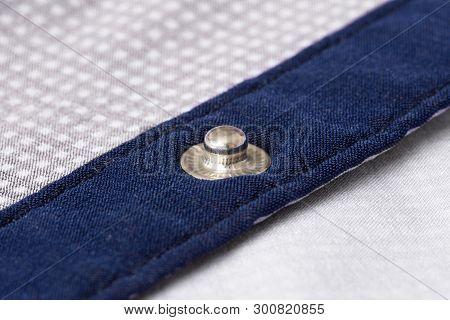 Press-stud (fastener) On Blue Shirt Plank Closeup.
