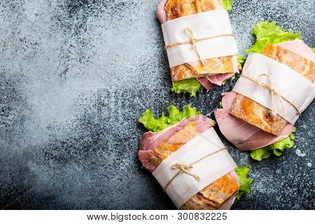 Fresh Ciabatta Sandwiches With Ham, Cheese, Lettuce, Tomatoes, Stone Concrete Background, Close-up,