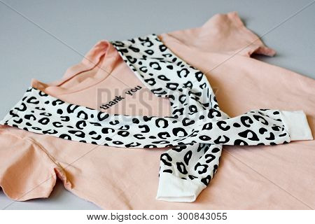 Casual And Trendy Clothes, Coral-colored T-shirt And Leopard Sweatshirt. Isolated Background. Trends