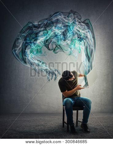 Perplexed guy seated lifting his laptop looking to fix problems as dark smog hand comes out of notebook computer. Technology monster with big claws trying to scare. Negative influence of virtual world poster