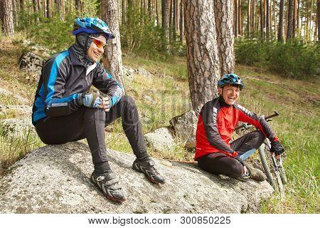 Group Of Cyclists On A Halt. Team Outdoors. Mountain Bike.