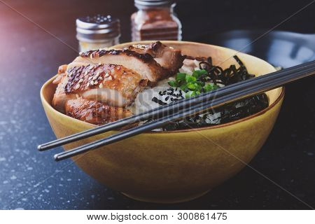 Rice Cup With Grilled Chicken In Japanese Style.