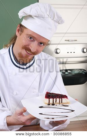 Young Chef With Piece Of Cake