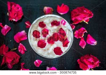 Popular Indian & Asian Ramadan dish or Ramazan dessert i.e Kheer in a glass plate along with some rose flowers and petals on it. poster